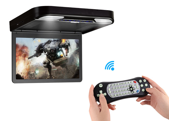 roof mount flip down car dvd player with game being played on it.