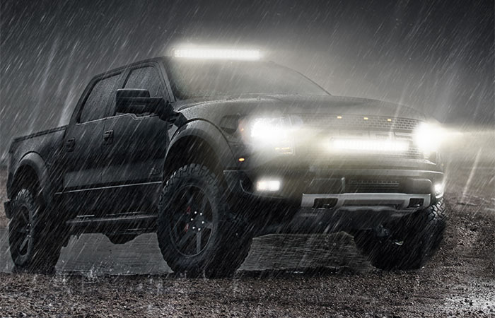 "led lights mounted on suv in the rain with caption ""IP68 waterproof"""